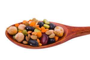 collection of beans, legumes, peas, lentils on wooden spoons
