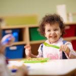preschooler eating pasta